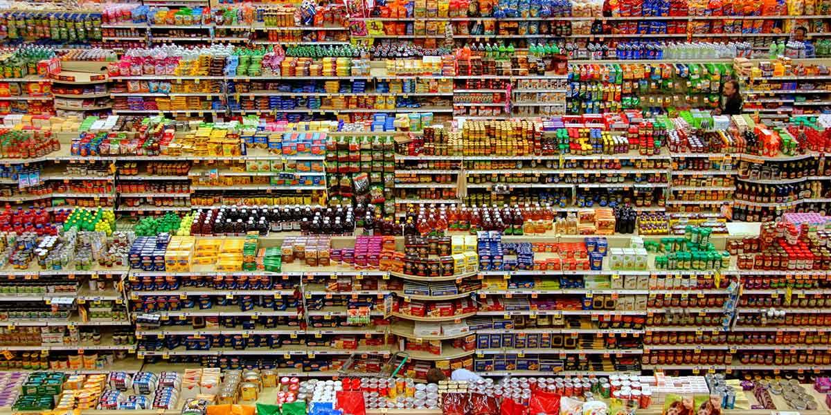 Fully stocked supermarket shelves