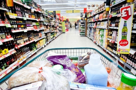 Full shopping trolley being pushed down aisle - Rathbone Investment Management